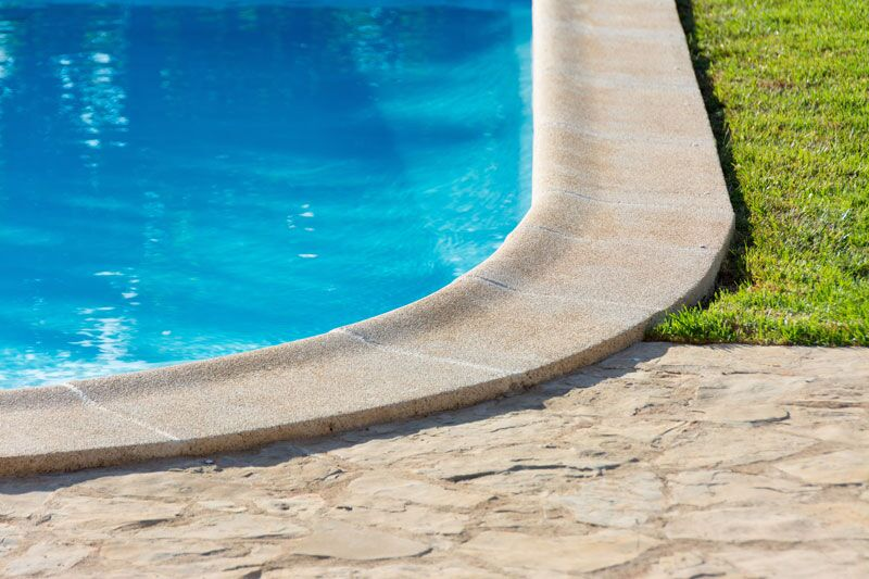 edge of an in-ground swimming pool