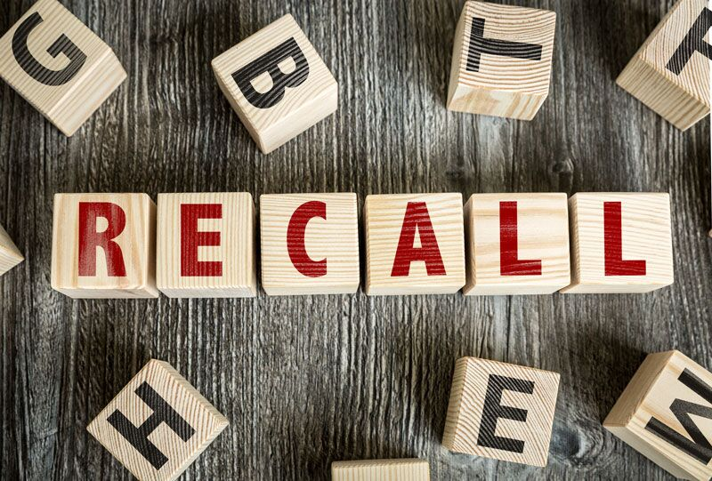 "wooden blocks spelling out ""recall"""